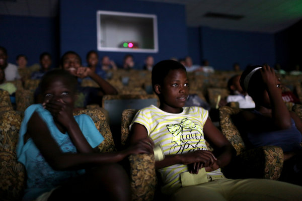 "Residents of Kwamashu watching ""Joe Bullet"" this month. The film, released in 1972, was banned after only two showings. Credit Joao Silva/The New York Times"